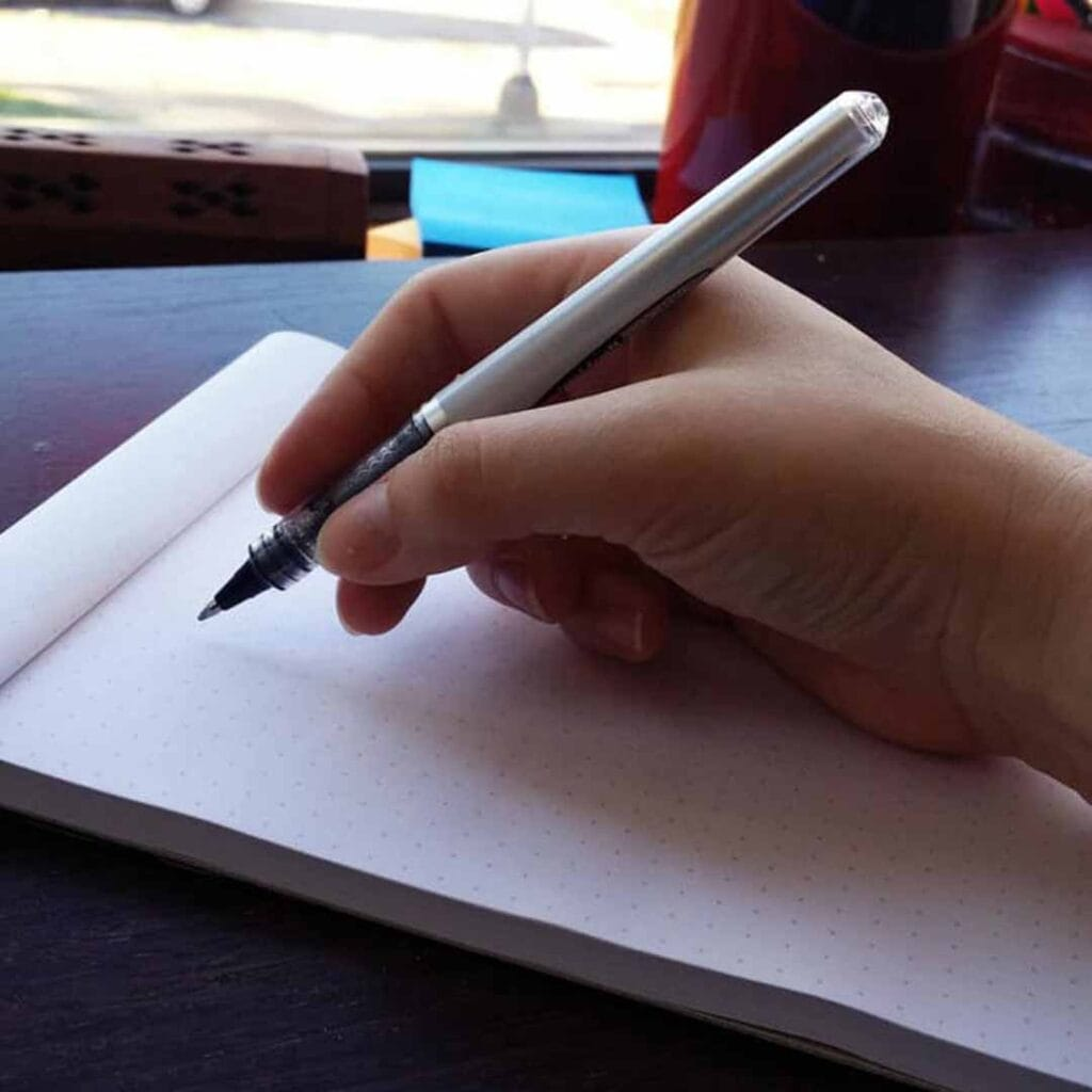 woman's handing holding a fountain pen
