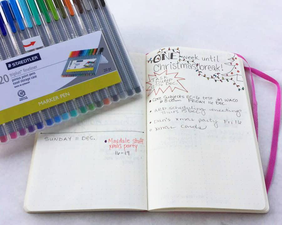A bullet journal spread is open. This spread is helping a teacher plan her week before Christmas break begins.
