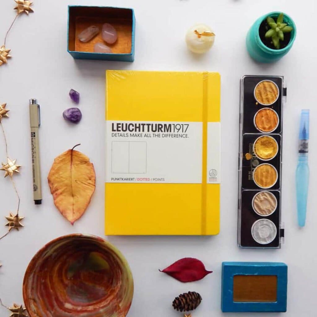 image of flat lay photography using yellow journal
