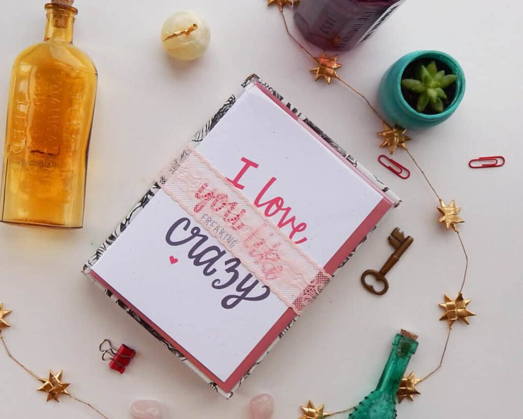 flat lay photograph of card that says I Love You Like Crazy with a bottle and succulent and skeleton key