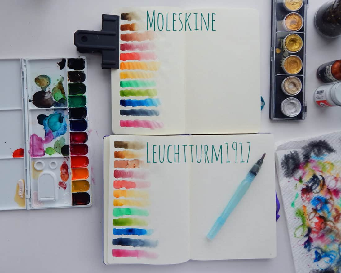 Gradient swatches have been painted on the pages of a Moleskine journal and a Leuchtturm1917 journal.