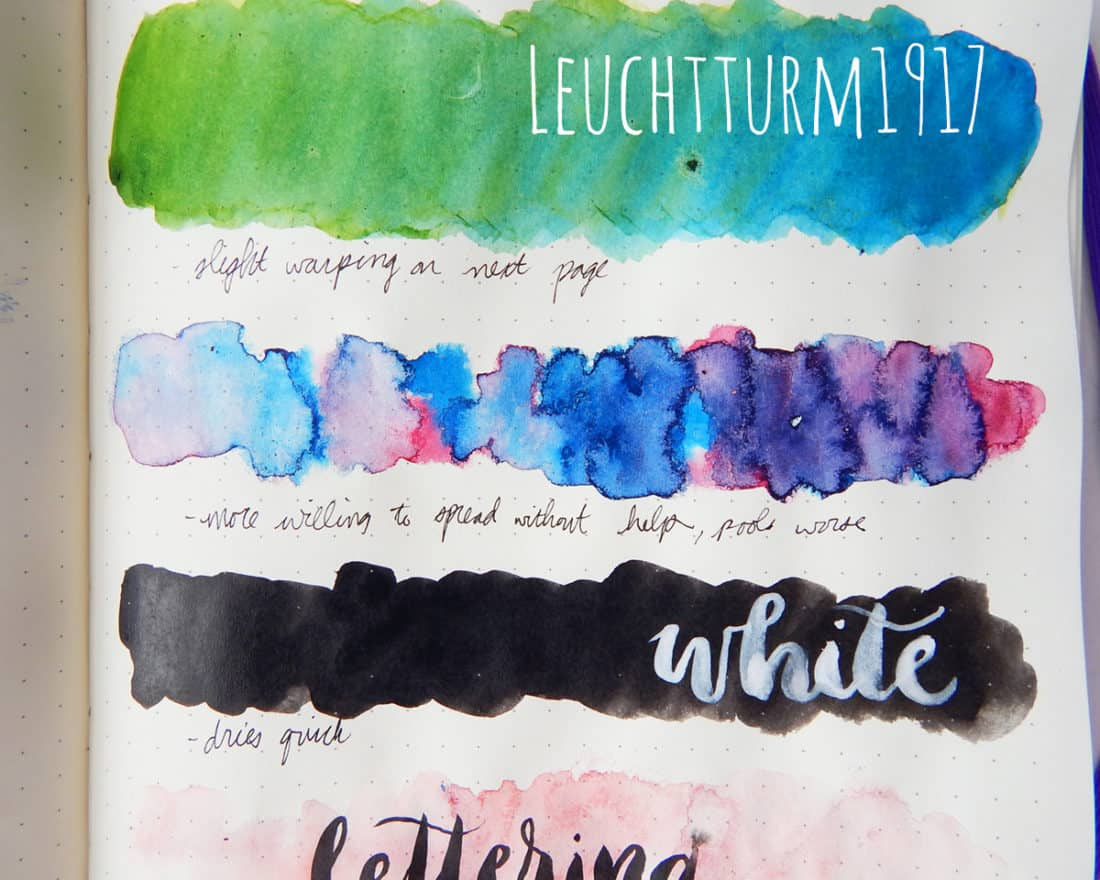 A close-up view of the results of the blending, wet on wet, and ink flat wash tests on a Leuchtturm1917 journal page.