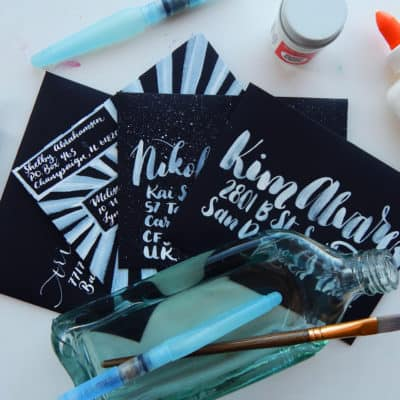 How to Address a Black Envelope with Lettering Style