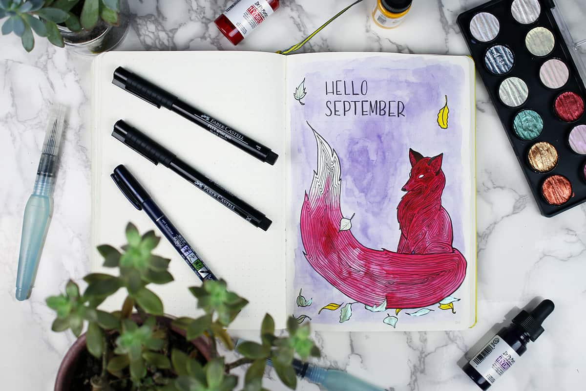"A September bullet journal cover page with a watercolor fox painting and the words ""hello September"""