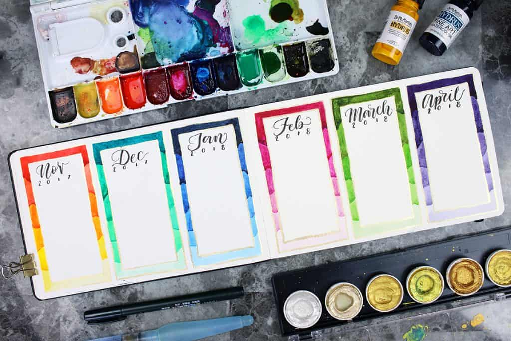 A future log in a watercolor bullet journal. The log covers a six month span, from November 2017 through April 2018. The borders of the months have been created using watercolor paints.