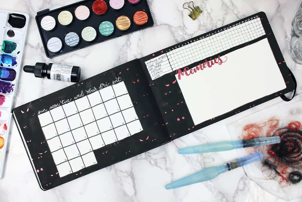 A watercolor bullet journal monthly spread for the month of October. The watercolor background is black with pairs of red eyes. The monthly spread also features a habit tracker and memories section.