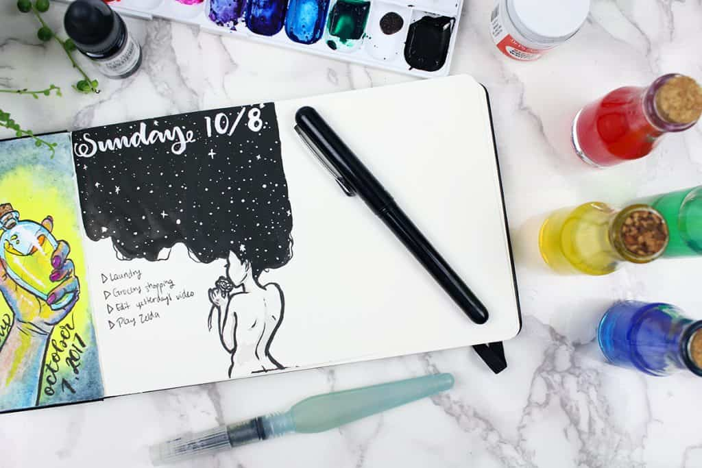 A monochromatic daily spread in a watercolor bullet journal. This daily spread features the back of a woman, with her hair making up the black background. Stars have been painted into her hair with white paint.