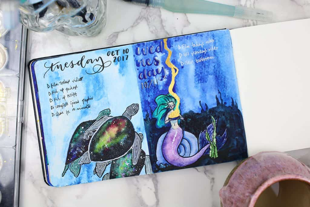 A daily spread for a watercolor bullet journal. This spread features a mermaid holding a bowl of gold under the sea.