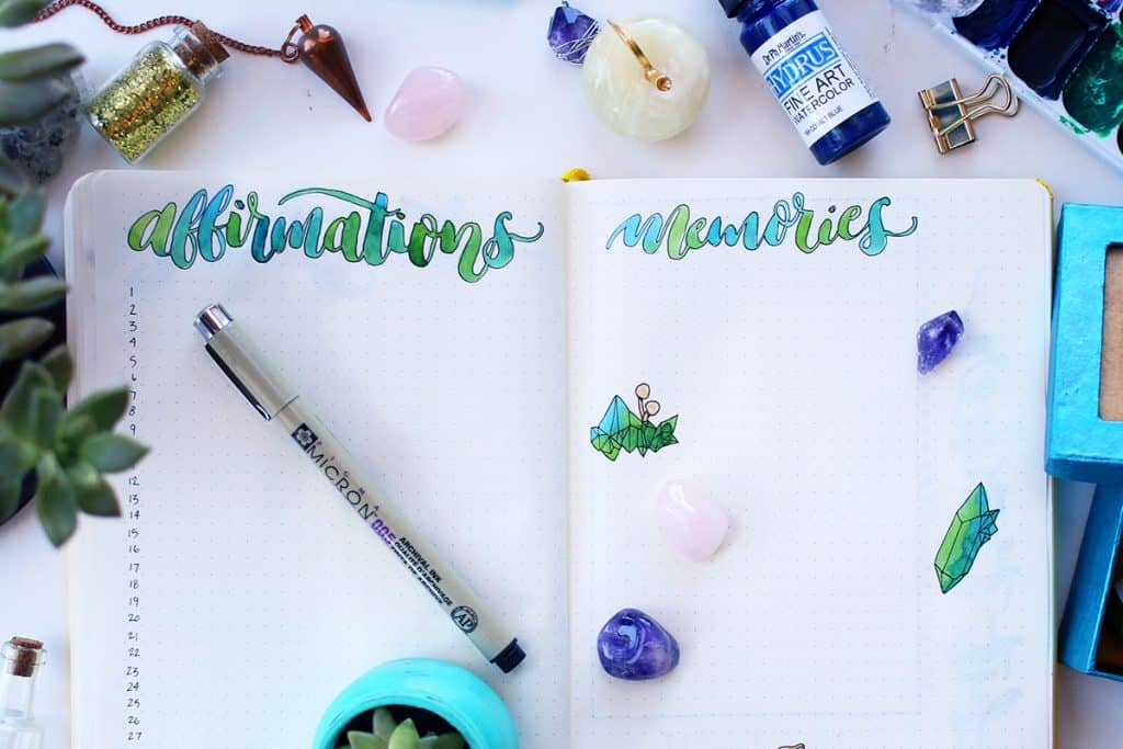 A bullet journal open to the affirmations log