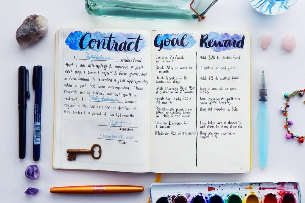A goals and rewards contract signed in a bullet journal