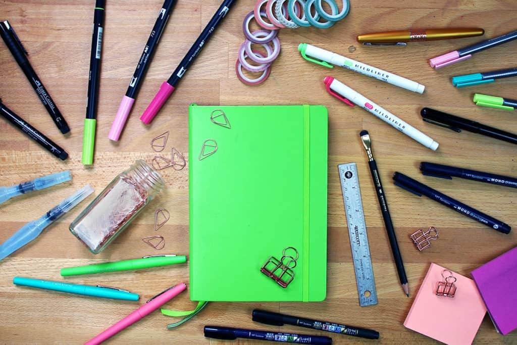 an overhead view of all of my best bullet journal supplies