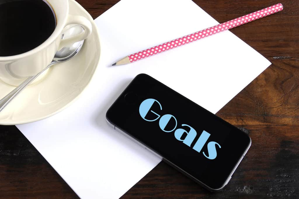 New Year Resolution or Goals Planning concept with smart phone d
