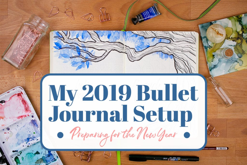 "Photo of journal on desk with graphic overlay saying ""My 2019 Bullet Journal Setup: Preparing for the New Year""."