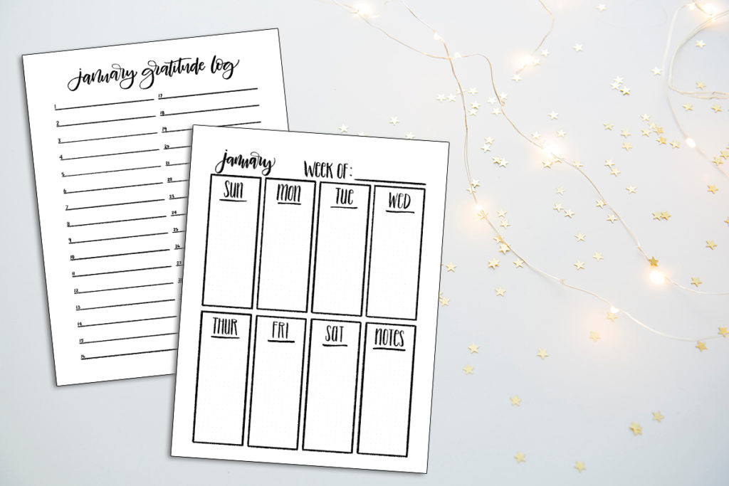 January gratitude log and weekly page template printables superimposed over a table with fairy lights glowing nearby.