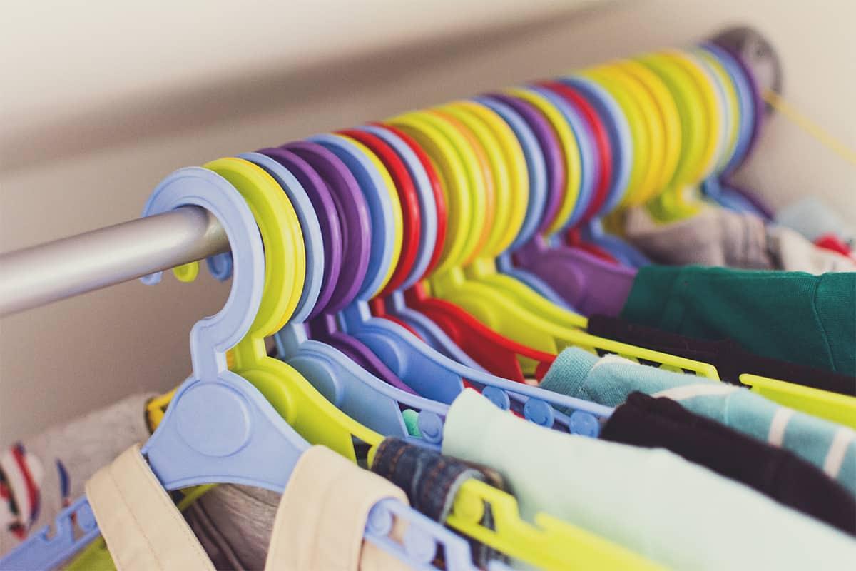 Closeup of multicolored hangers in a closet