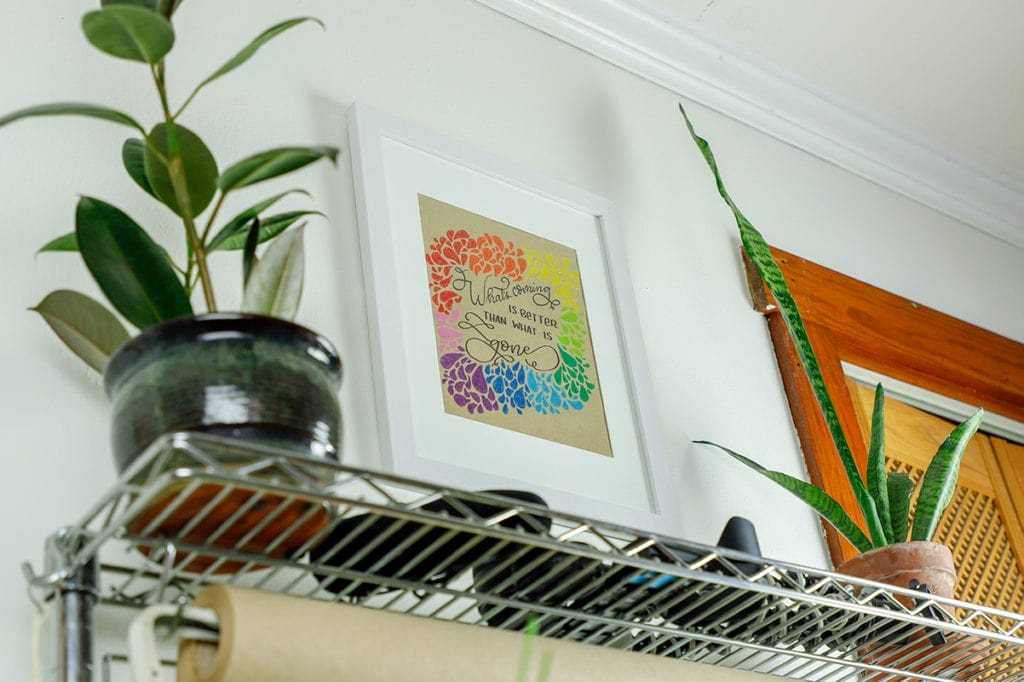 Colorful DIY wall art framed and hanging on wall.