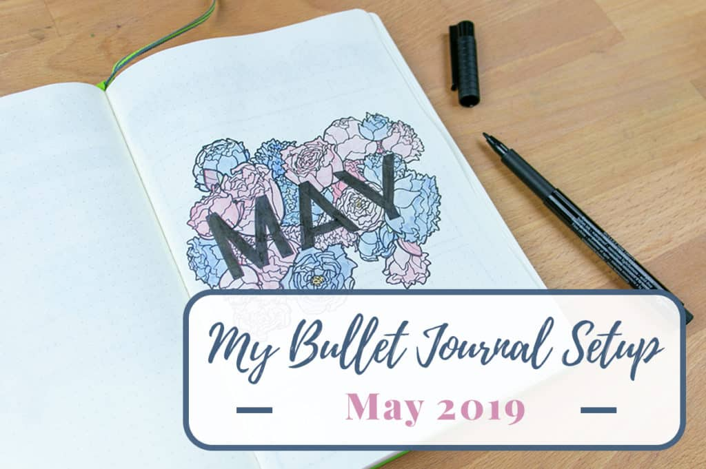 May 2019 bullet journal setup on a desk with graphic overlay with title of post.