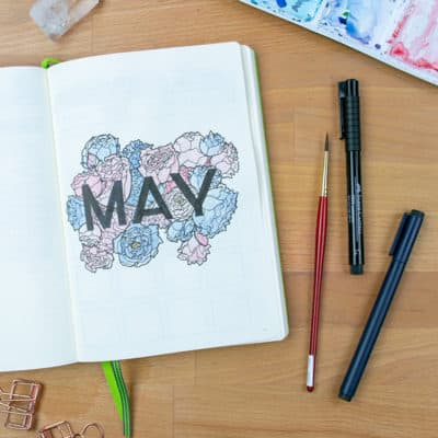 May bullet journal cover page with flower artwork.
