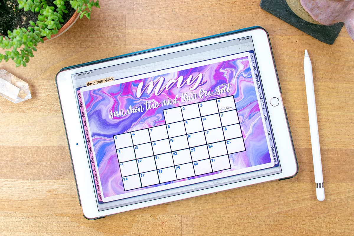 My digital bullet journal on the desk open to the May calendar.
