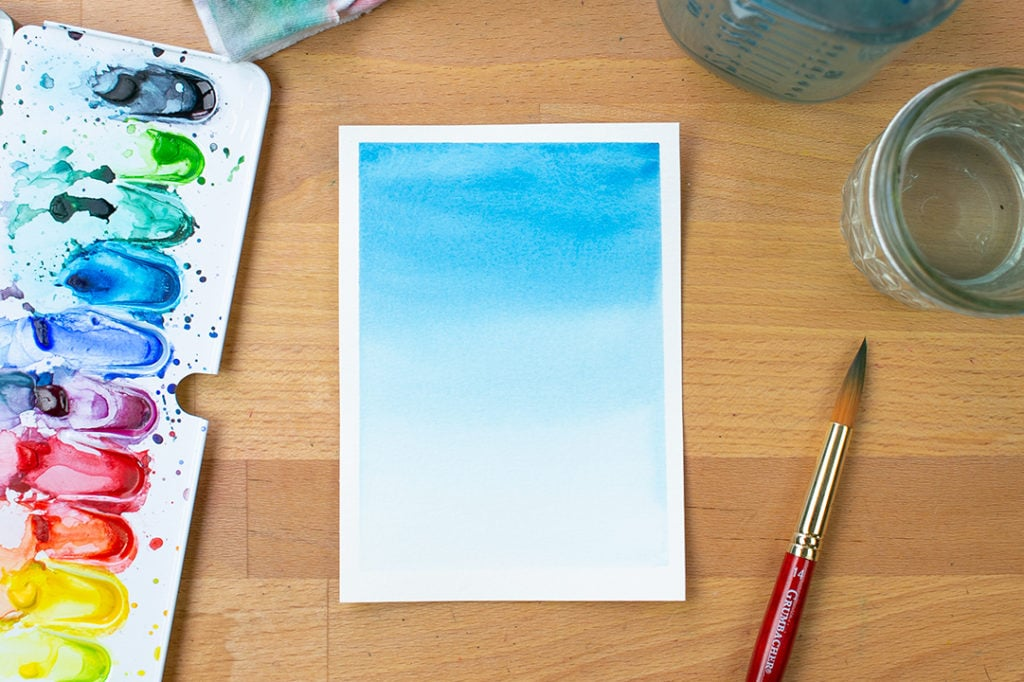 Completed gradient watercolor wash in blue.