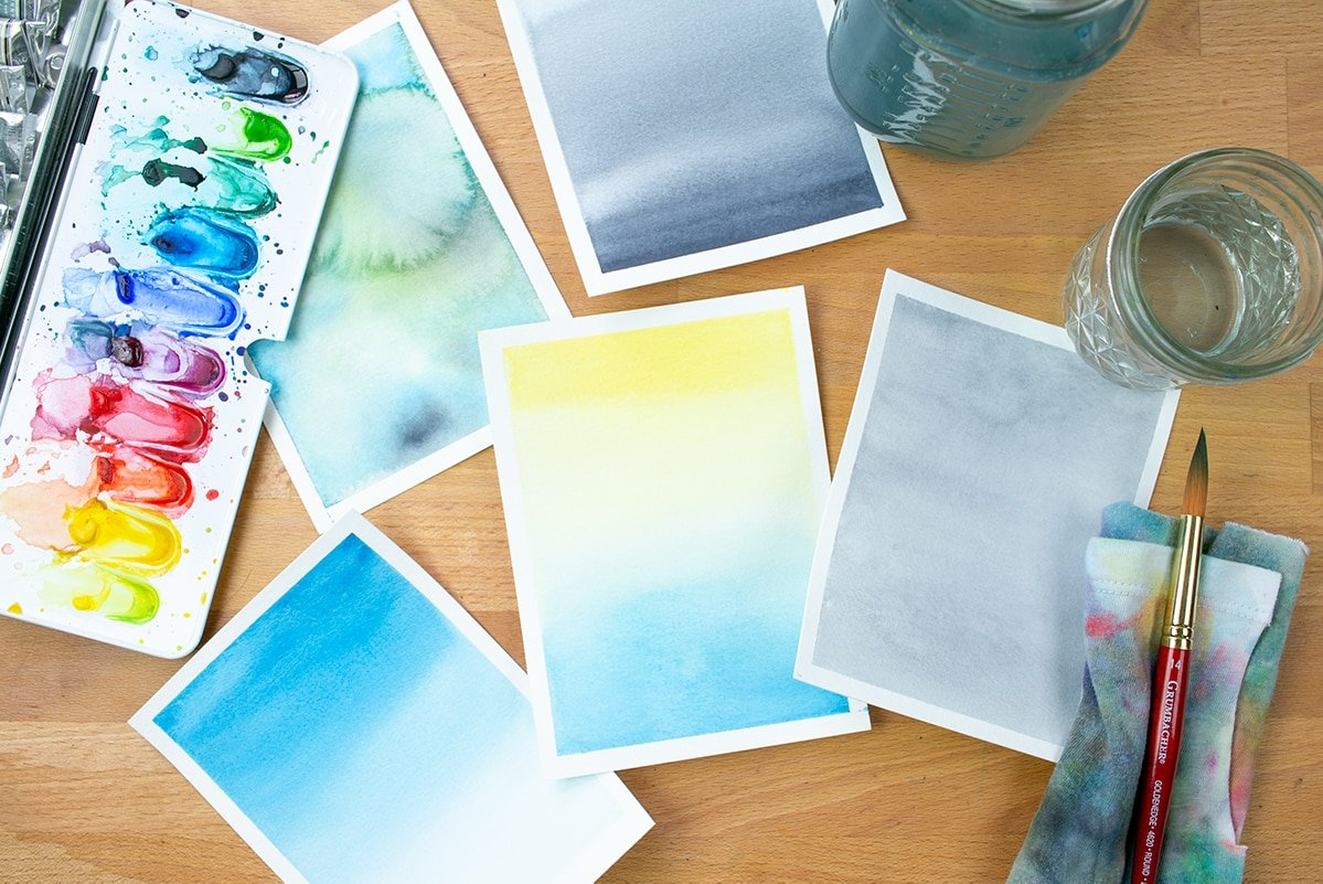 Top down photo showing all the finished watercolor washes from the tutorial on a desk.