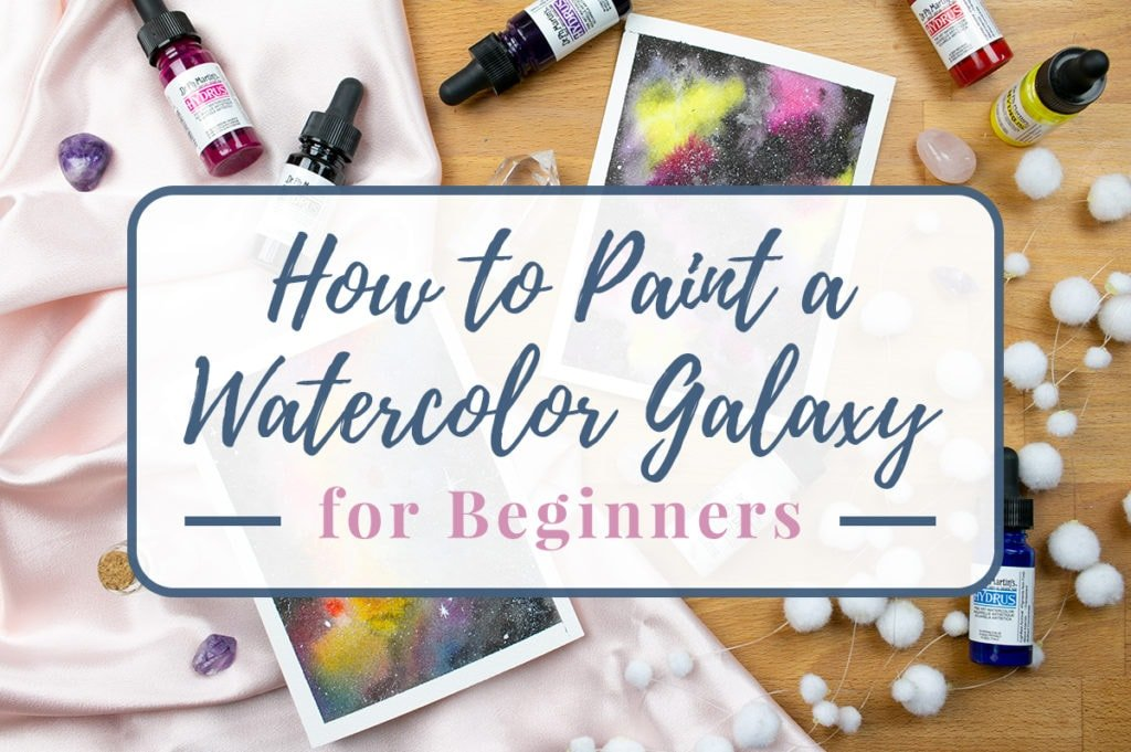 Title graphic over a photo of completed watercolor galaxies