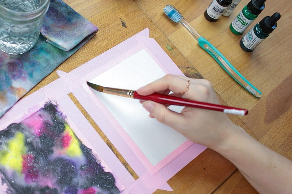 Apply clean water to the watercolor paper