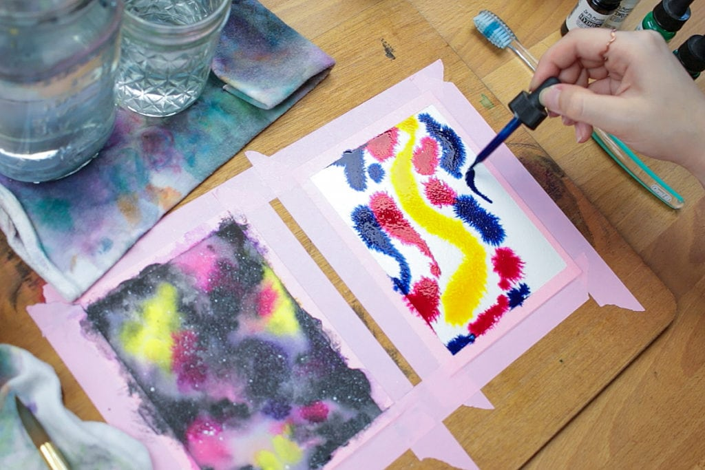 Add the darkest color after the other colors in your watercolor galaxy