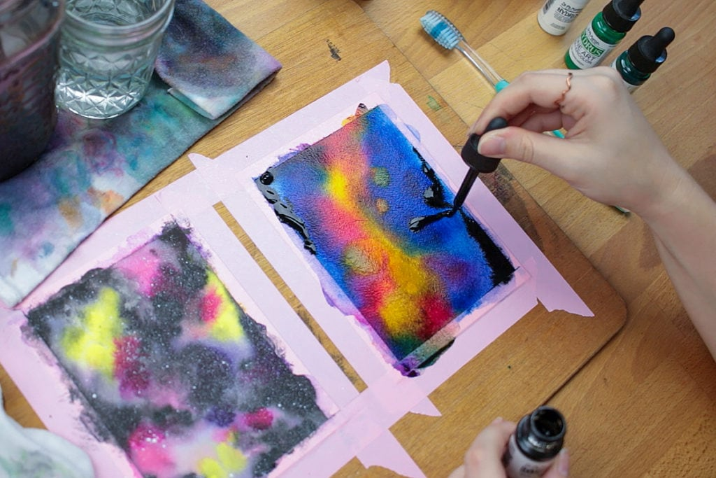 Add black paint to the edges of your watercolor galaxy