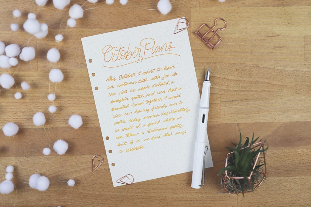 Paper with handwritten note in cursive on desk with fountain pen.