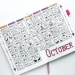 A planner spread consisting of Halloween doodles