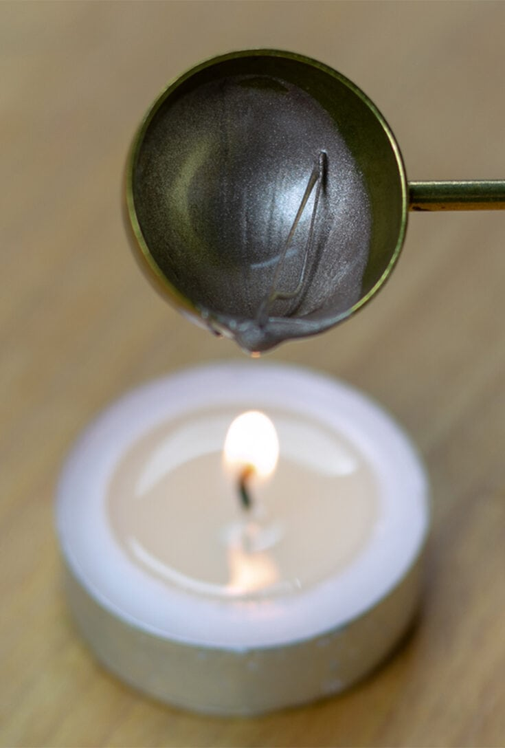 Melting hardened wax over flame