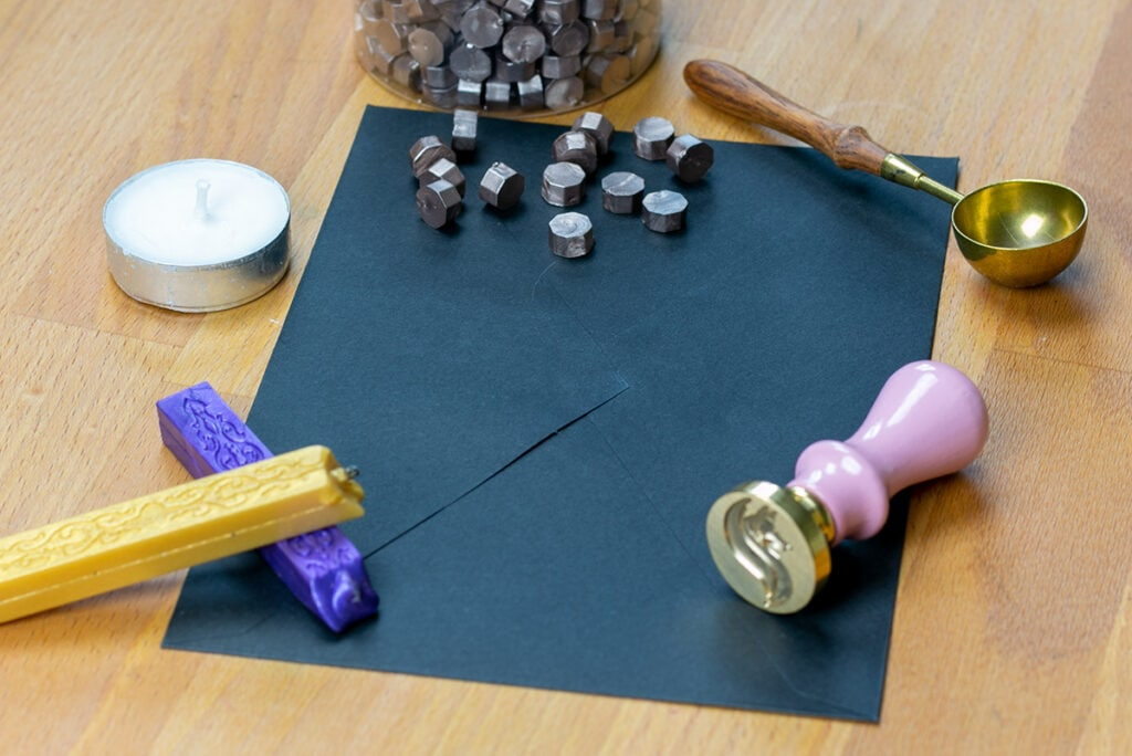 Display of sealing wax materials splayed out on a table.