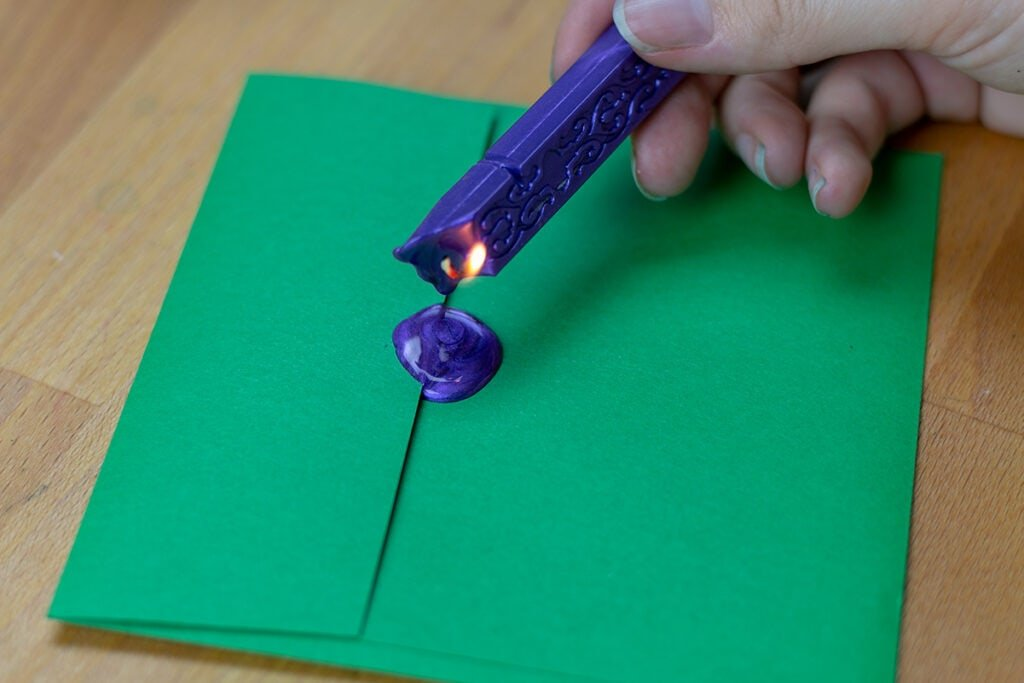 Sealing Wax Stick Dripping onto envelope