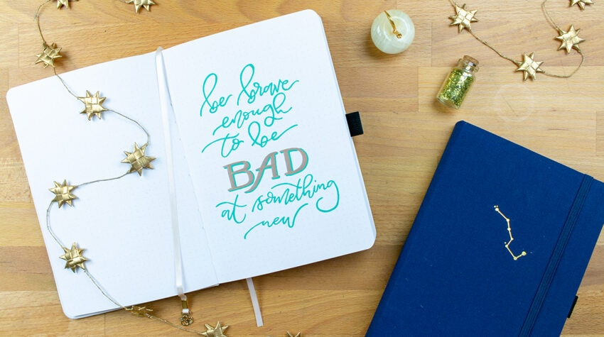 "Lettering saying, ""be brave enough to be bad at something new"""