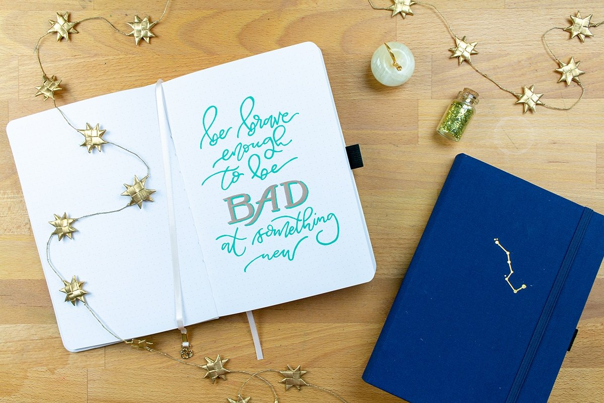 """Lettering saying, """"be brave enough to be bad at something new"""""""