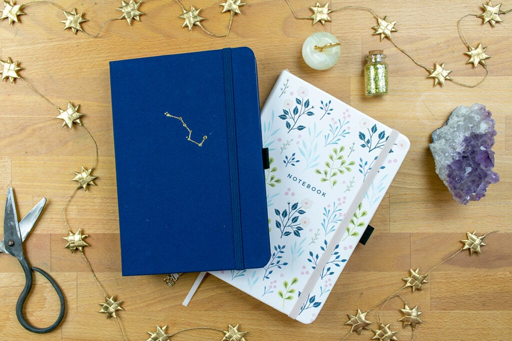 Two journals on desk for Archer & Olive Dot Grid Journal Review