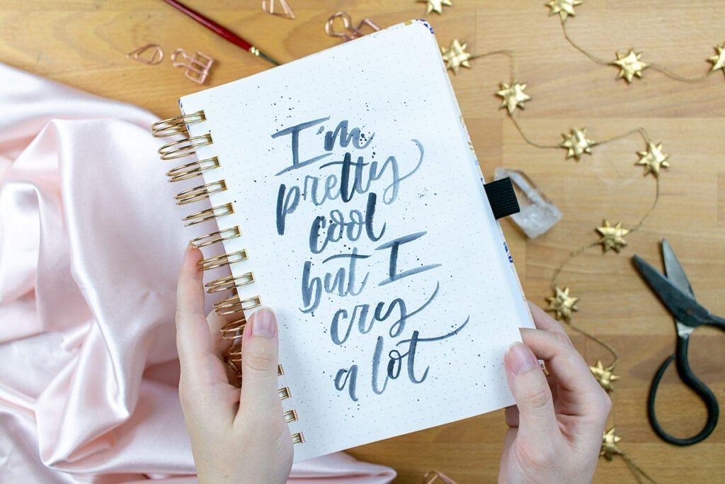 "Watercolor lettering saying ""I'm pretty cool but I cry a lot."""
