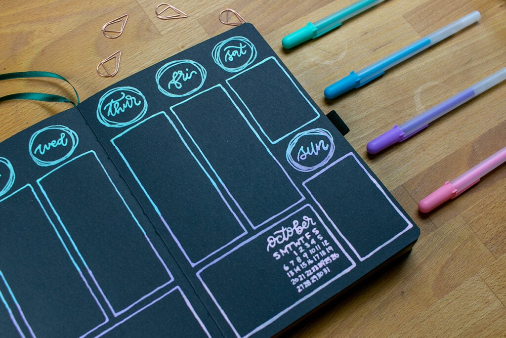 Weekly spread in blackout journals created with opaque gel pens
