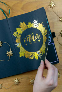 Golden leaves painted into Archer & Olive Blackout! Journal.