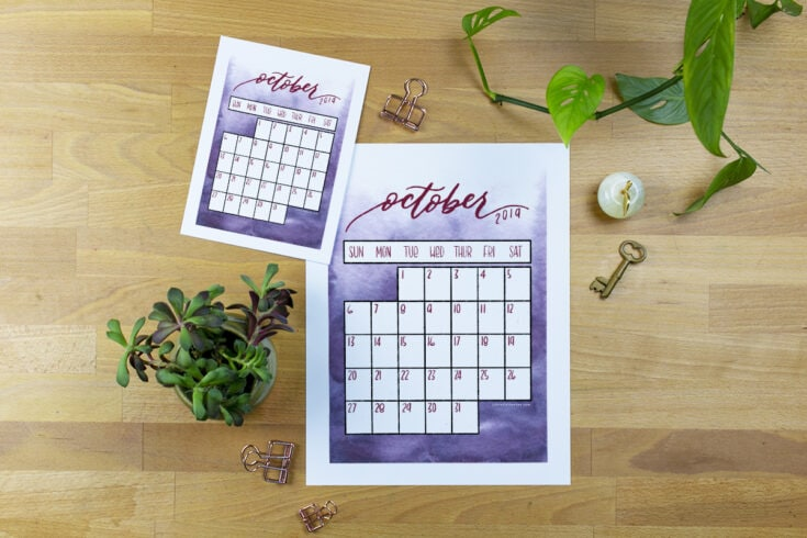 Image of October calendar printable on desk in both full sized and A5 sized.
