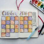 An October bullet journal spread using metallic watercolor paints