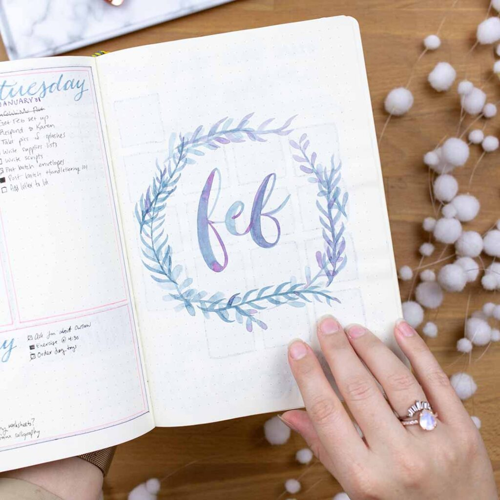 February bullet journal spread idea with feb encircled by a wreath