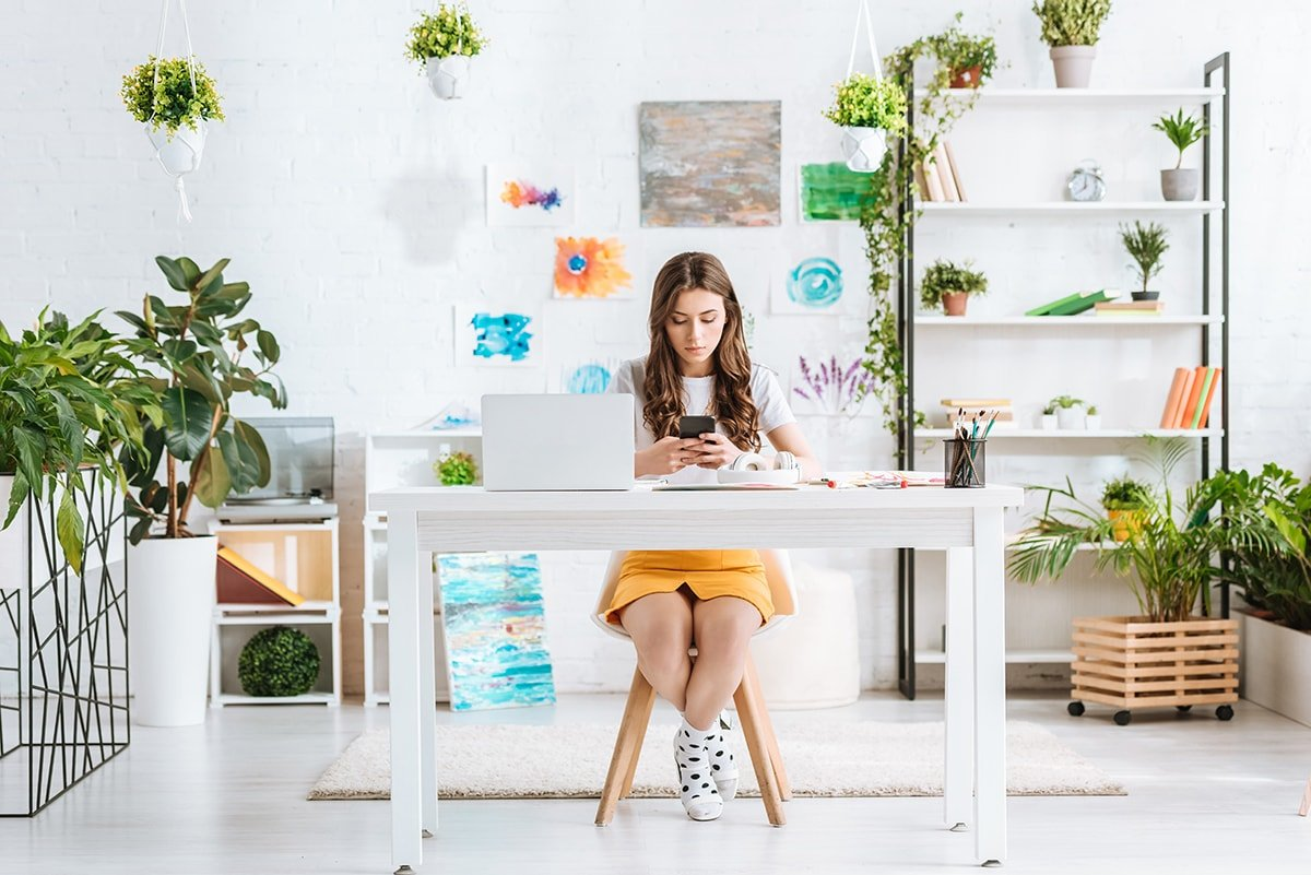 Woman working at desk with phone