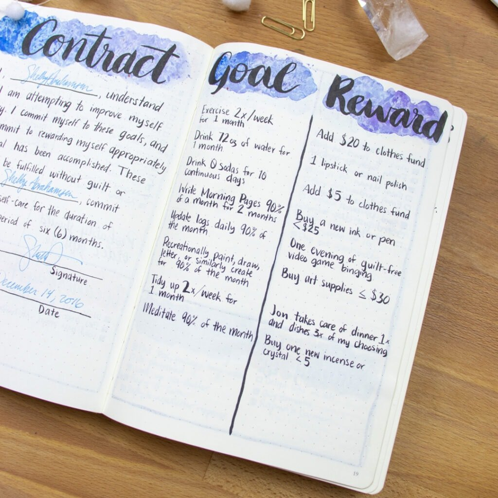 A close-up of the 'Goal/Reward' page in a bullet journal. Each goal written has a reward associated with achieving that goal.