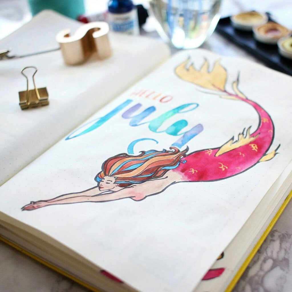 A close up of a watercolor mermaid to show how the gold paint reflects the light