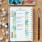 Five written affirmations in bullet journal