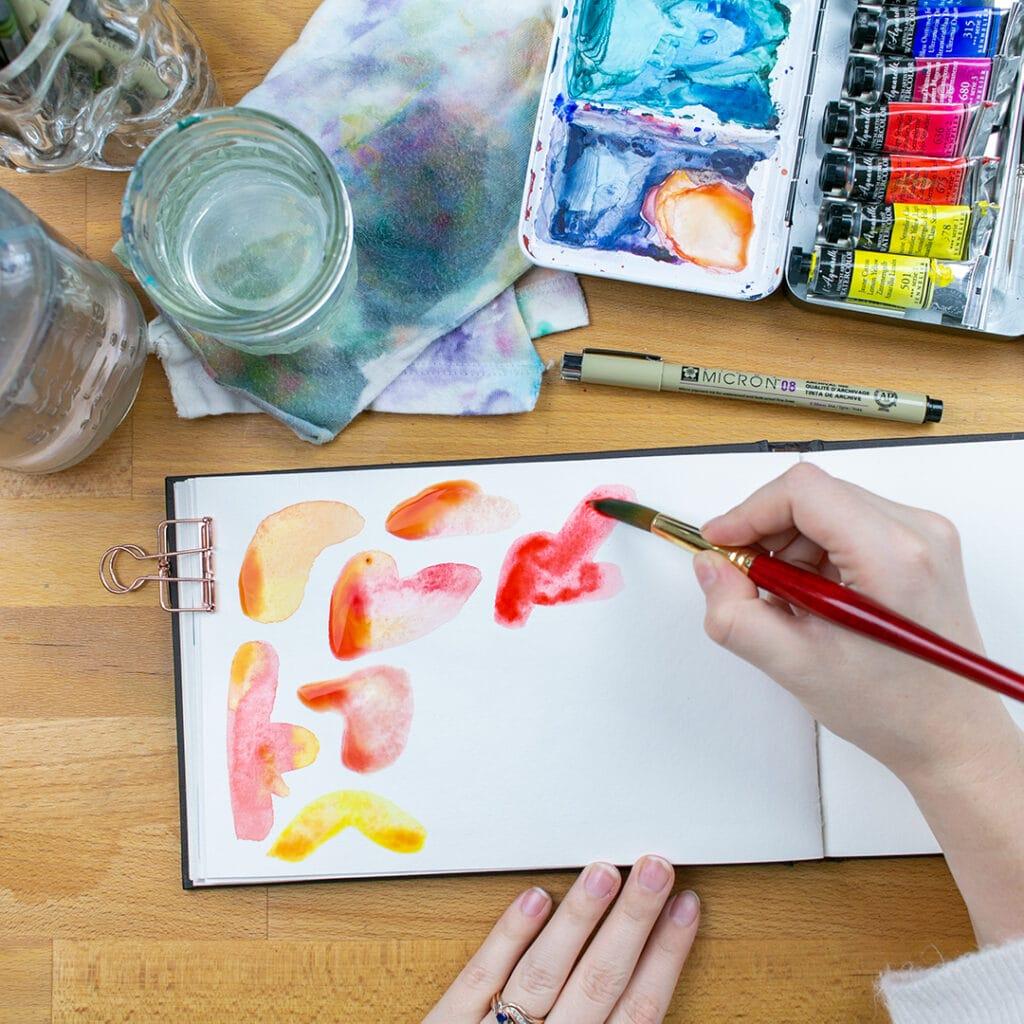 Watercolor blobs in sketchbook