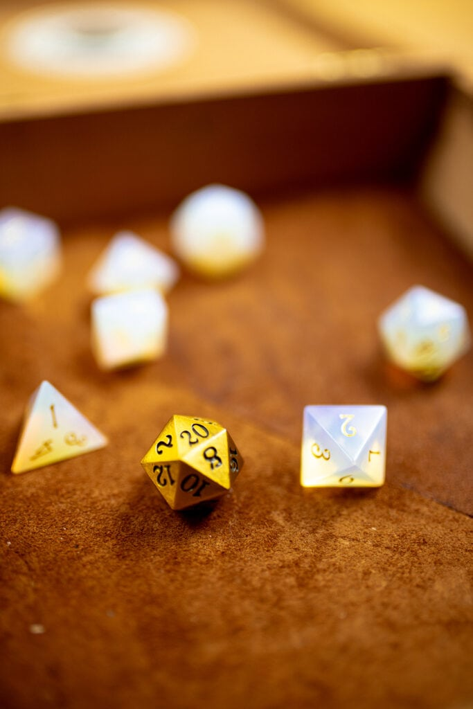 Assortment of dice in a suede lined tray.